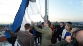 Young people born on the day independence was restored hoisted the flag at the Tall Hermann Tower